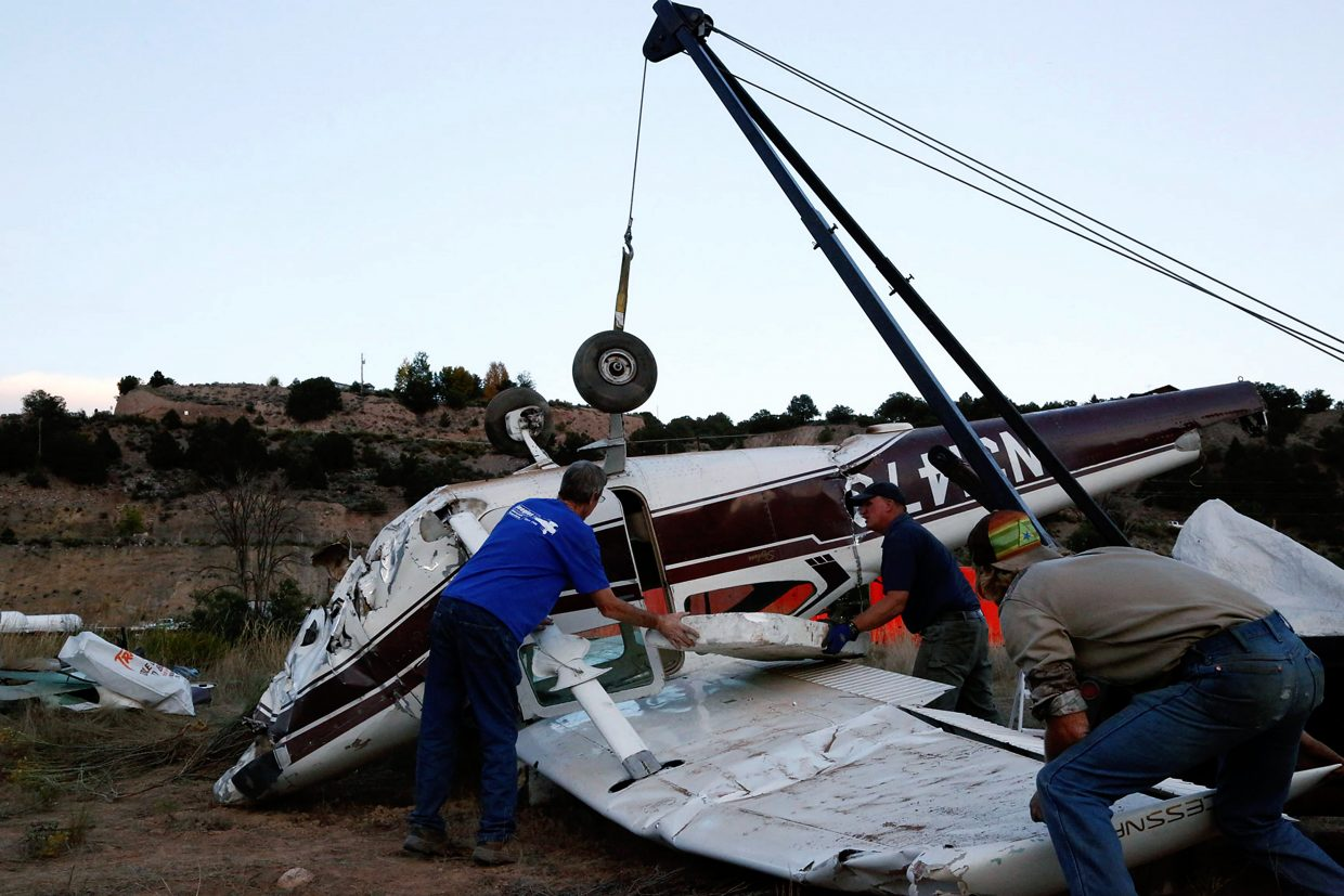 A 1964 Cessa is lifted by a Beegles Aircraft Service crane for transportation to Greeley, Co.  The plane crashed landed Sunday morning into a field near Cattle Creek after leaving the Aspen airport and having engine trouble.