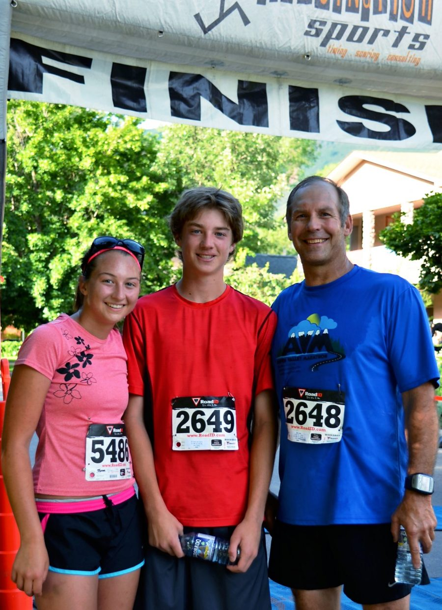 Larry Thrun (right) with his children Melissa and Mathew Thrun after running the Strawberry Shortcut 5k on Sunday morning.