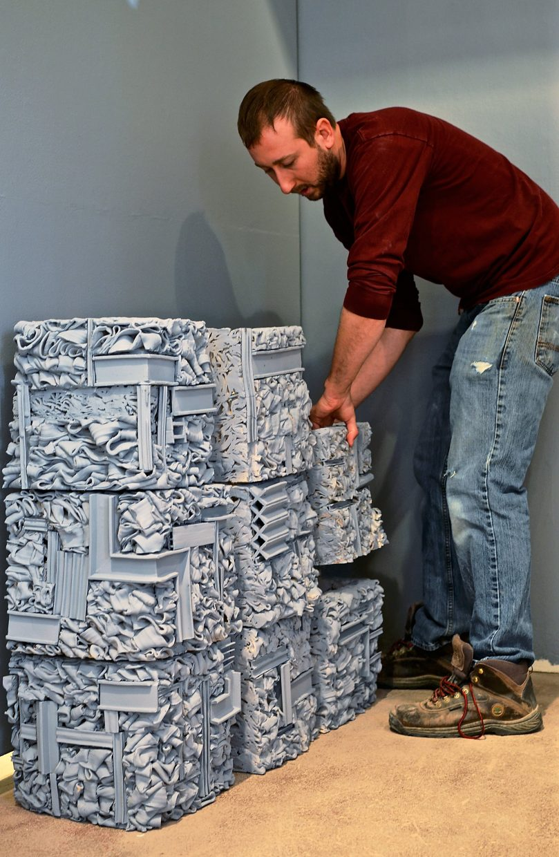 Carbondale Clay Center resident artist Matthew Eames works on his new exhibition