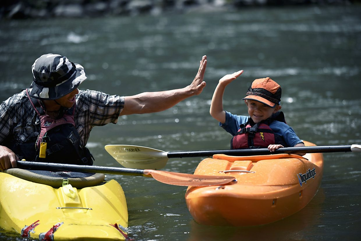 Six-year-old Dax and his and dad, Tommy enjoying the river.