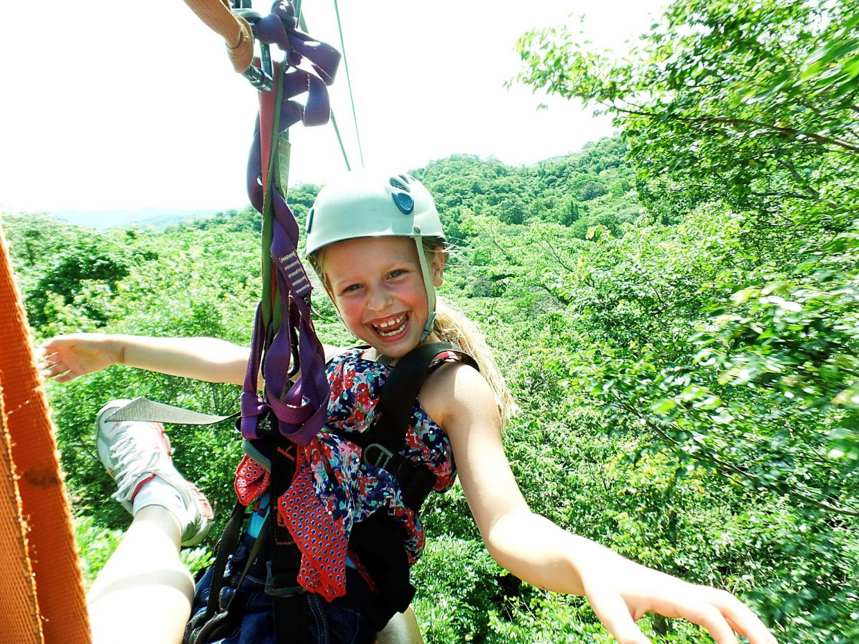 The girl above enjoys a day of ziplining. She loves twirling around and going upside down.