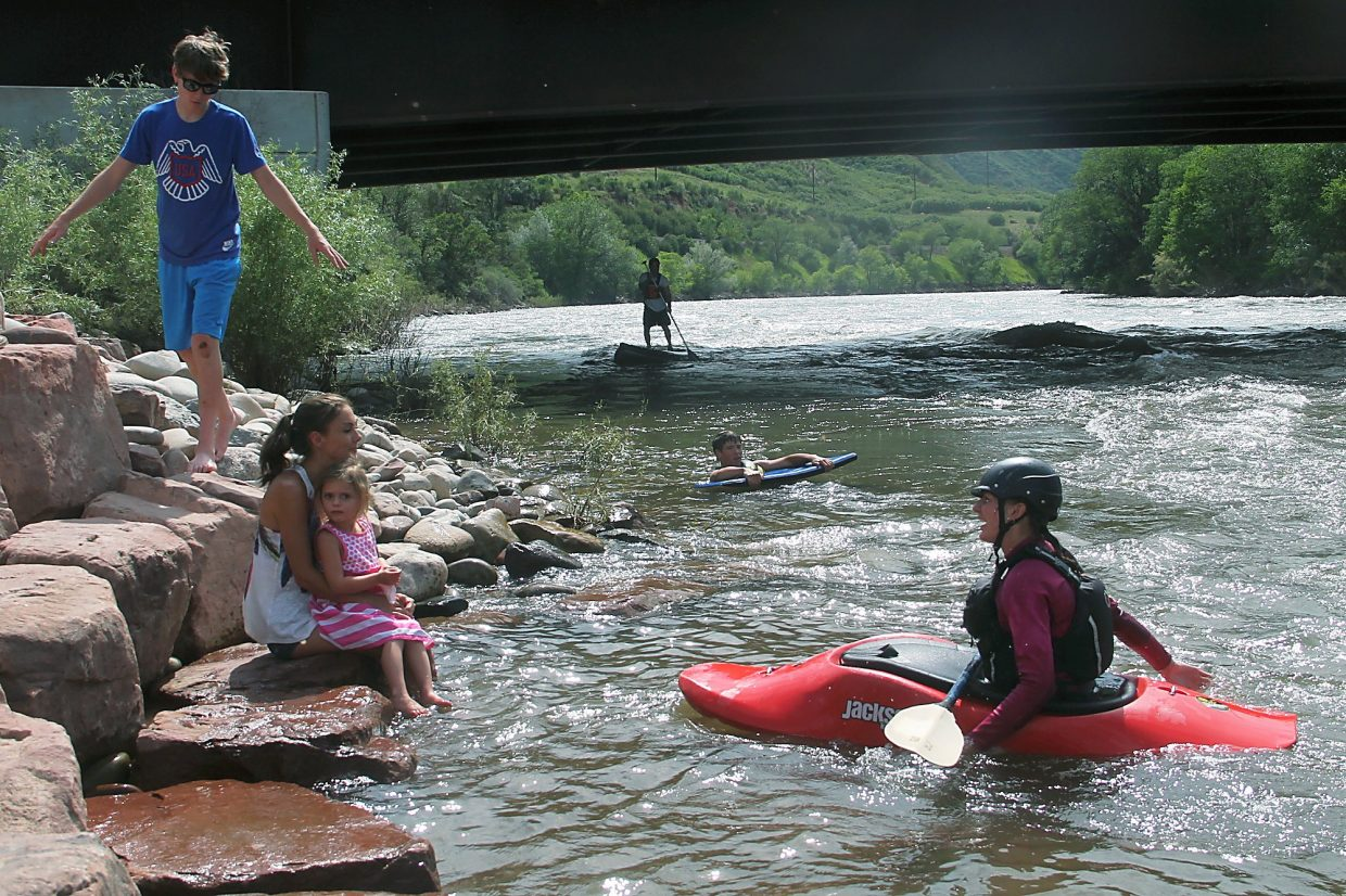 Locals escape from the heat at the Wave in Glenwood Springs on Tuesday afternoon. From left, Justin Thompson, Kim and Keira Ziegler, Wade Mooradin on the paddleboard, Dillon Leasure and Katie Julius.