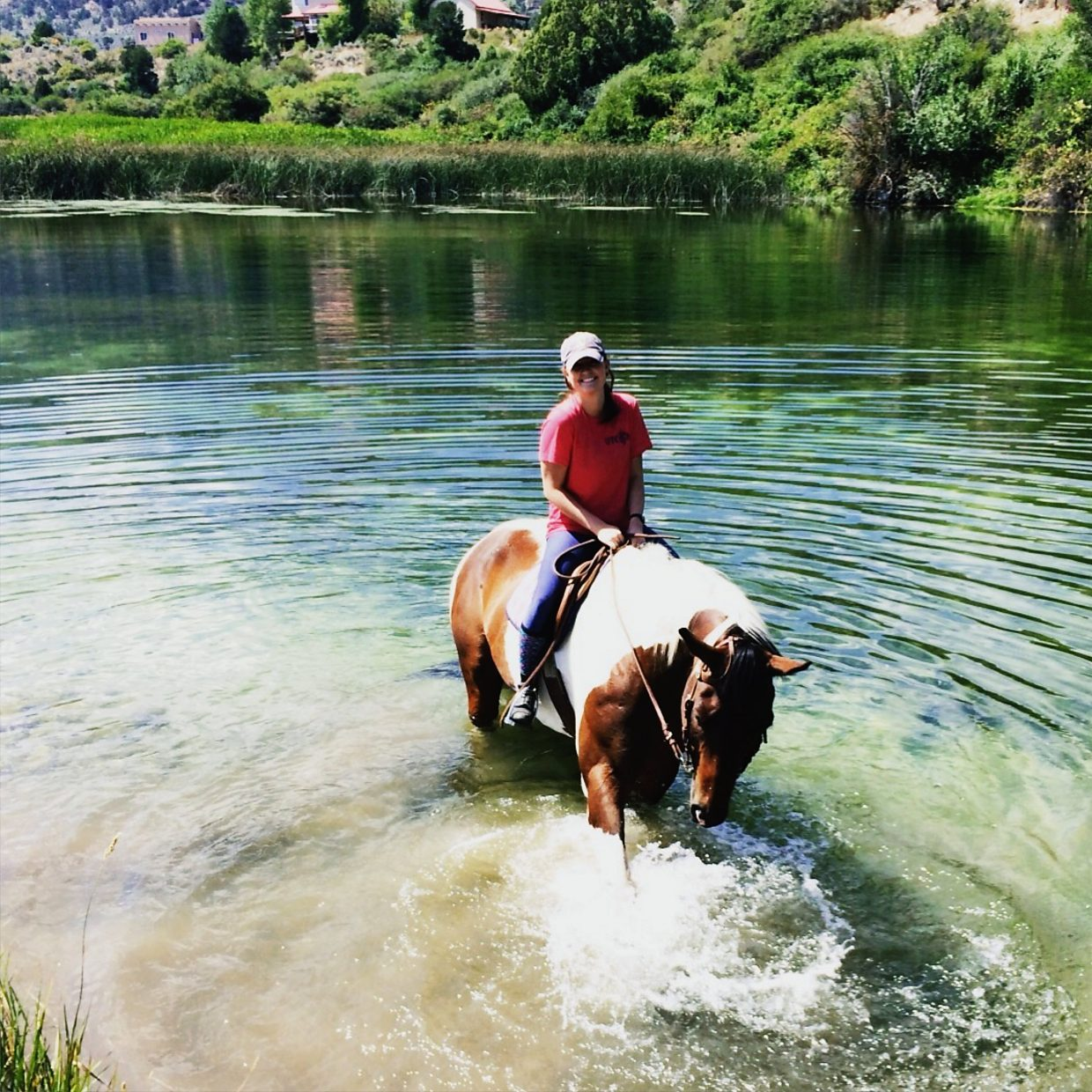 Molly Brinkmann and Snoopy cooling off in a pond along the Roaring Fork River.