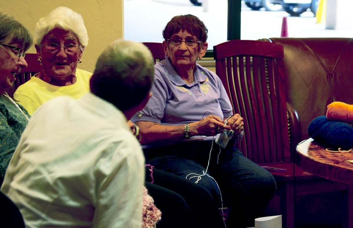 Threads of Love is partly a charity group, partly a social gathering. Martha Rabe chats with other knitters on a Tuesday meeting.