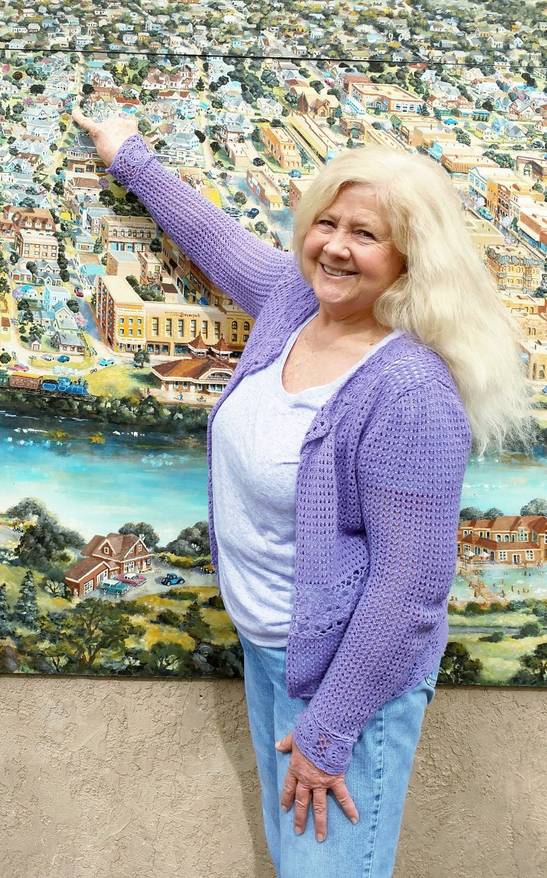 Janet Holley points to her home of 32 years on a mural of Glenwood Springs in Centennial Park.
