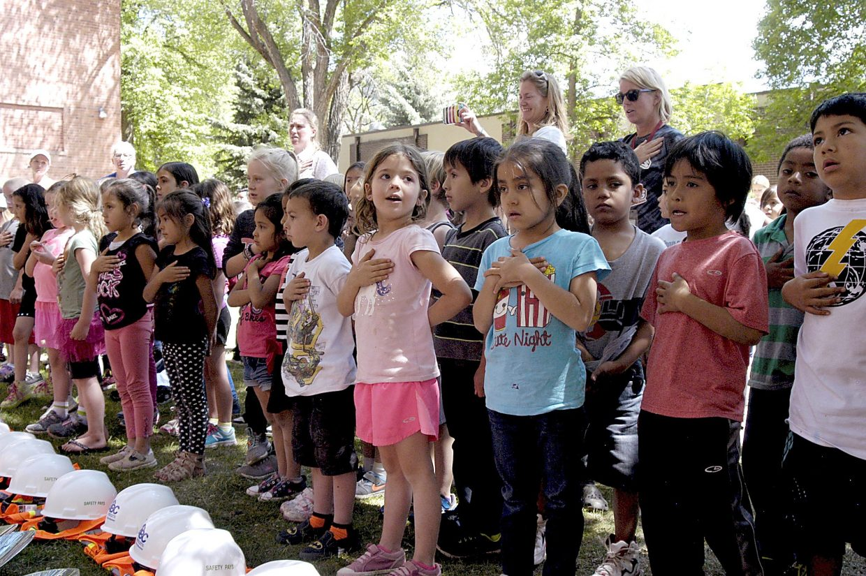 Glenwood Springs Elementary School students sing the national anthem to start the groundbreaking ceremony for the new GSES addition and renovation Tuesday afternoon.
