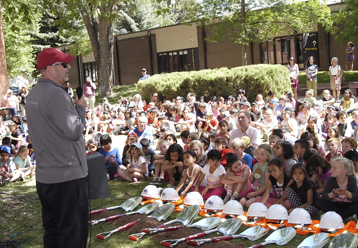 Norm Bolitho addresses students, parents and school officials in the courtyard at Glenwood Springs Elementary School during a groundbreaking ceremony Tuesday to mark the start of construction on the new GSES addition and renovation. The Bolitho wing, pictured in the background, was named after Norm's grandfather, former teacher and school principal Skip Bolitho. It will be torn down to make way for the new addition, along with an overhaul of the original 1920s building. The $30 million project is part of the larger $122 million bond issue approved by Roaring Fork School District voters last fall. Another groundbreaking ceremony takes place at 6:30 p.m. tonight at the Eastbank site south of Glenwood where a new $34 million K-8 school is being constructed.