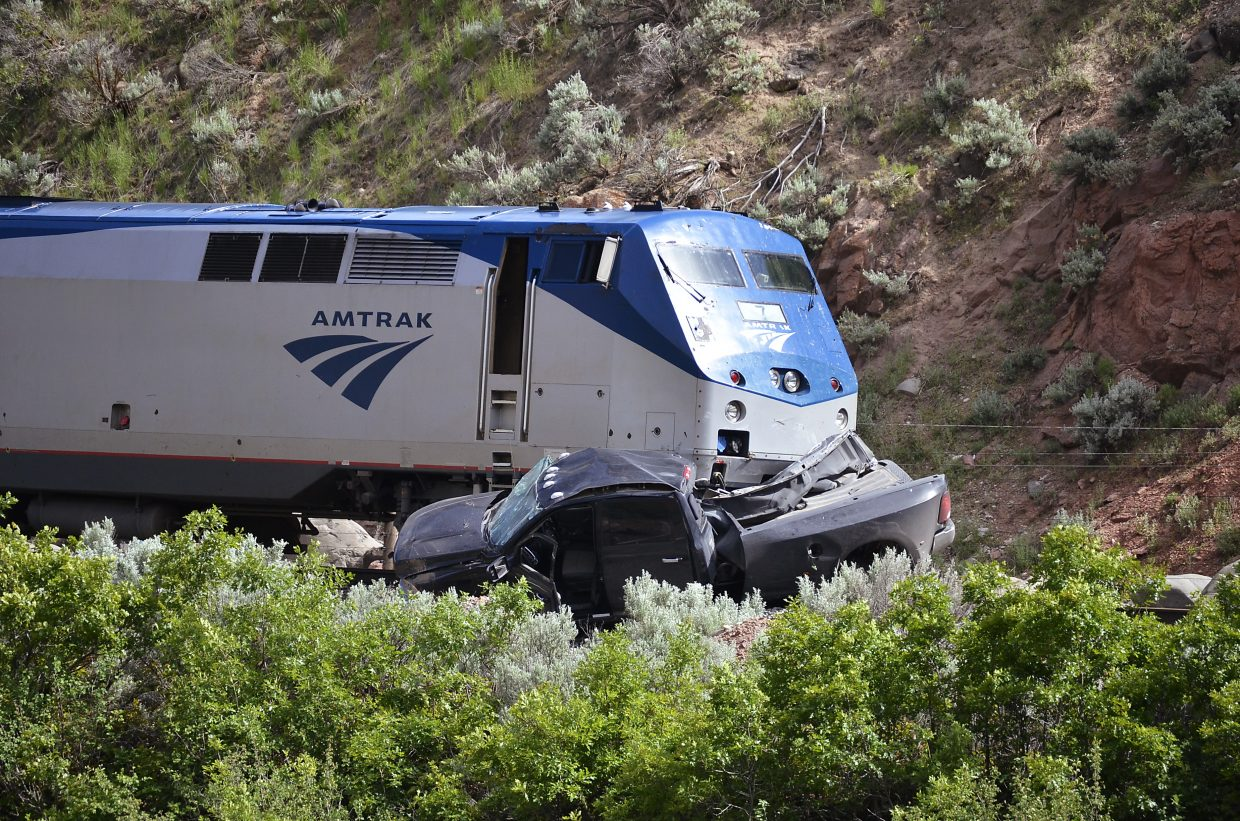 The pickup truck struck by Amtrak's westbound California Zephyr was pushed 500 feet before stopping in this position. The truck cab appears to be mostly intact, with the bed of the truck crushed by the nose of the train engine.