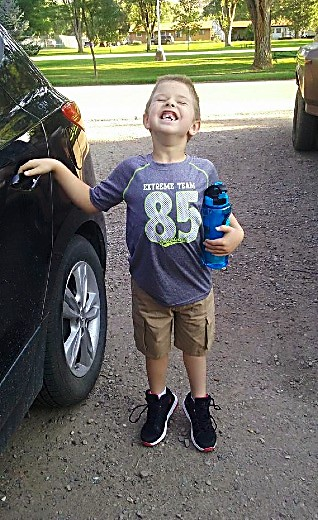 Christopher Shaffer gives a big smile before his first day of kindergarten at Cactus Valley Elementary School.