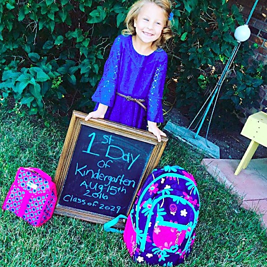 Maci Bartels smiles for a photo before her first day of kindergarten at Wamsley Elementary School.