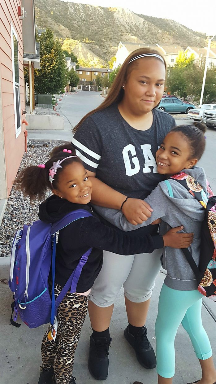 Vivian, Bree and Lillian Jackson share a hug before heading back to school Monday.Vivian is entering second grade at Highland Elementary School, Bree is a freshman at Rifle High School and Lilly is entering third grade at Highland.