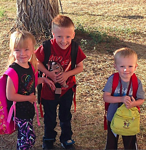 Rowan and Dominik Kyle pose for a photo with their brother, Dillon Clements, on the first day of school.