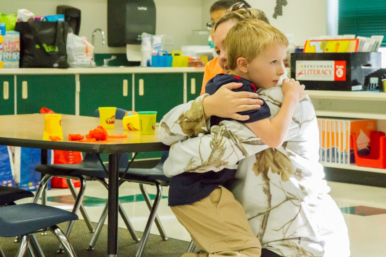 Mason Thompson saying goodbye to his mom Chelsea Gillow during his first day as a kindergartner at Sopris Elementary. Schools in the Roaring Fork School District started back up for a new year Wednesday morning. For more back-to-school photos go to postindependent.com.