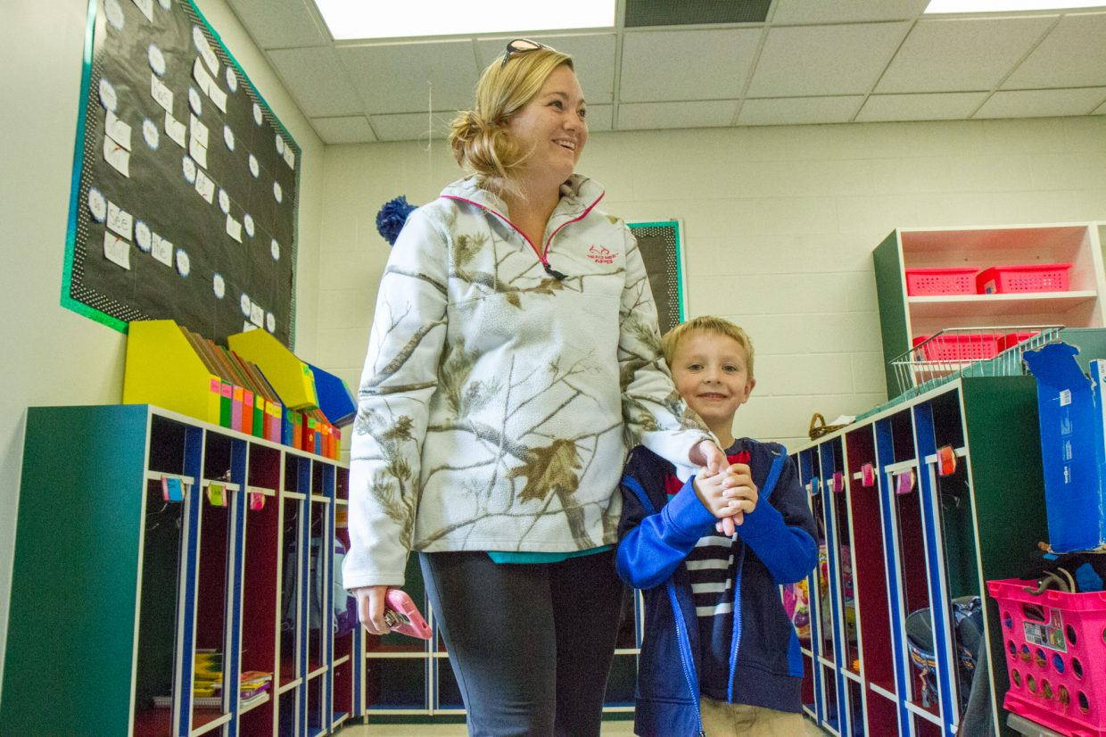 Mason Thompson and his mom learn the new morning routine in Jayda Armstrong's kindergarten class at Sopris Elementary.