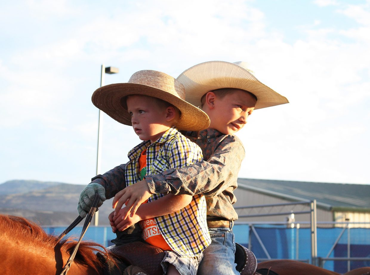 Mitchell Smelser, left, and Clayton Rossi go for a ride Monday night at the 2016 Garfield County Fair and Rodeo in Rifle.