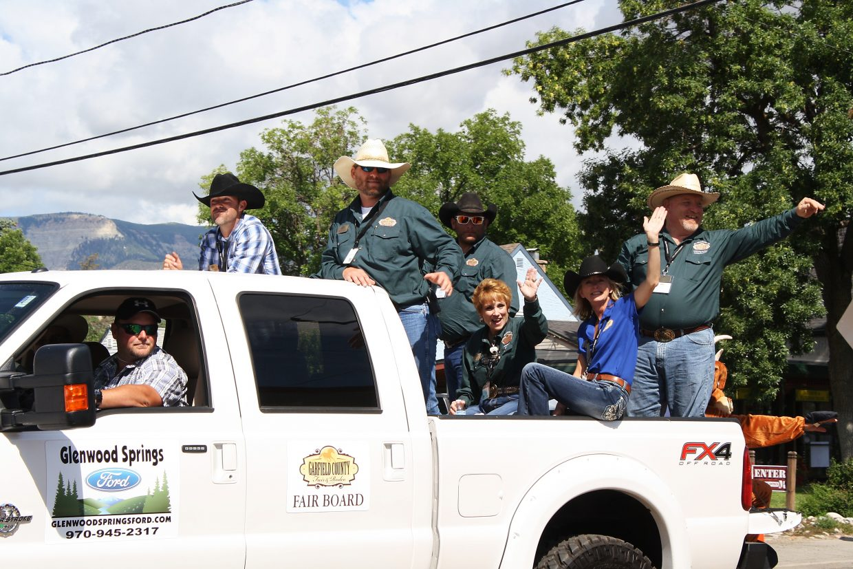 The Garfield County Fair Board waives at people watching the annual parade.