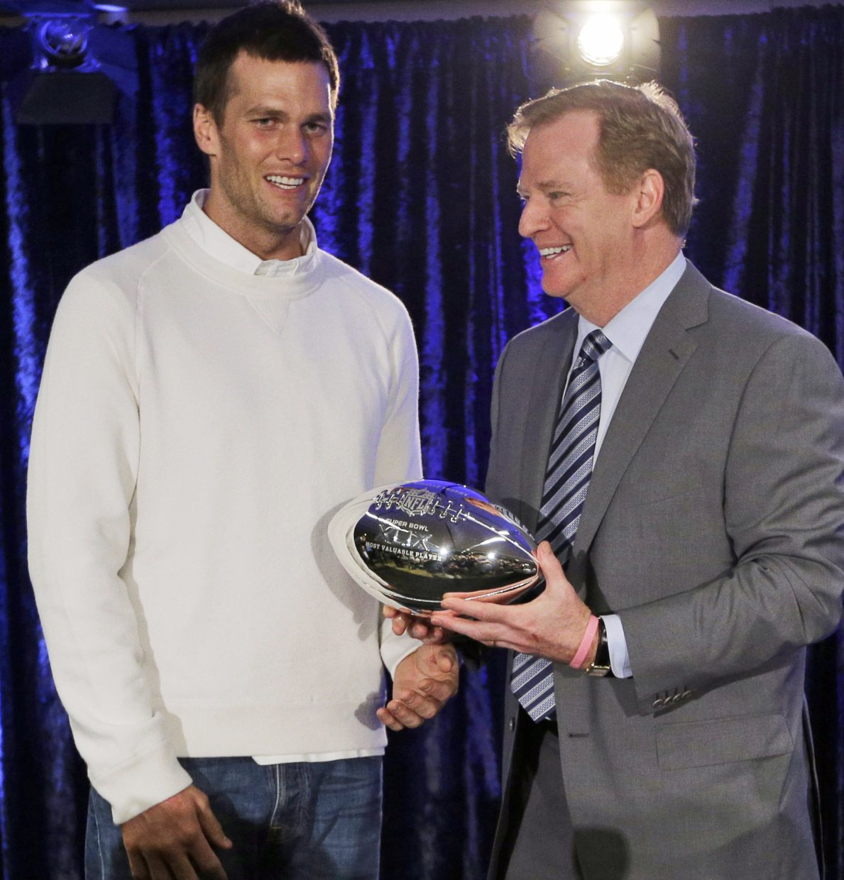 FILE - In this Feb. 2, 2015, file photo, New England Patriots quarterback Tom Brady poses with NFL Commissioner Rodger Goodell during a news conference after NFL football's Super Bowl XLIX in Phoenix, Ariz. Sept. 1 marks 10 years that  Goodell has served as NFL commissioner. (AP Photo/David J. Phillip, File)