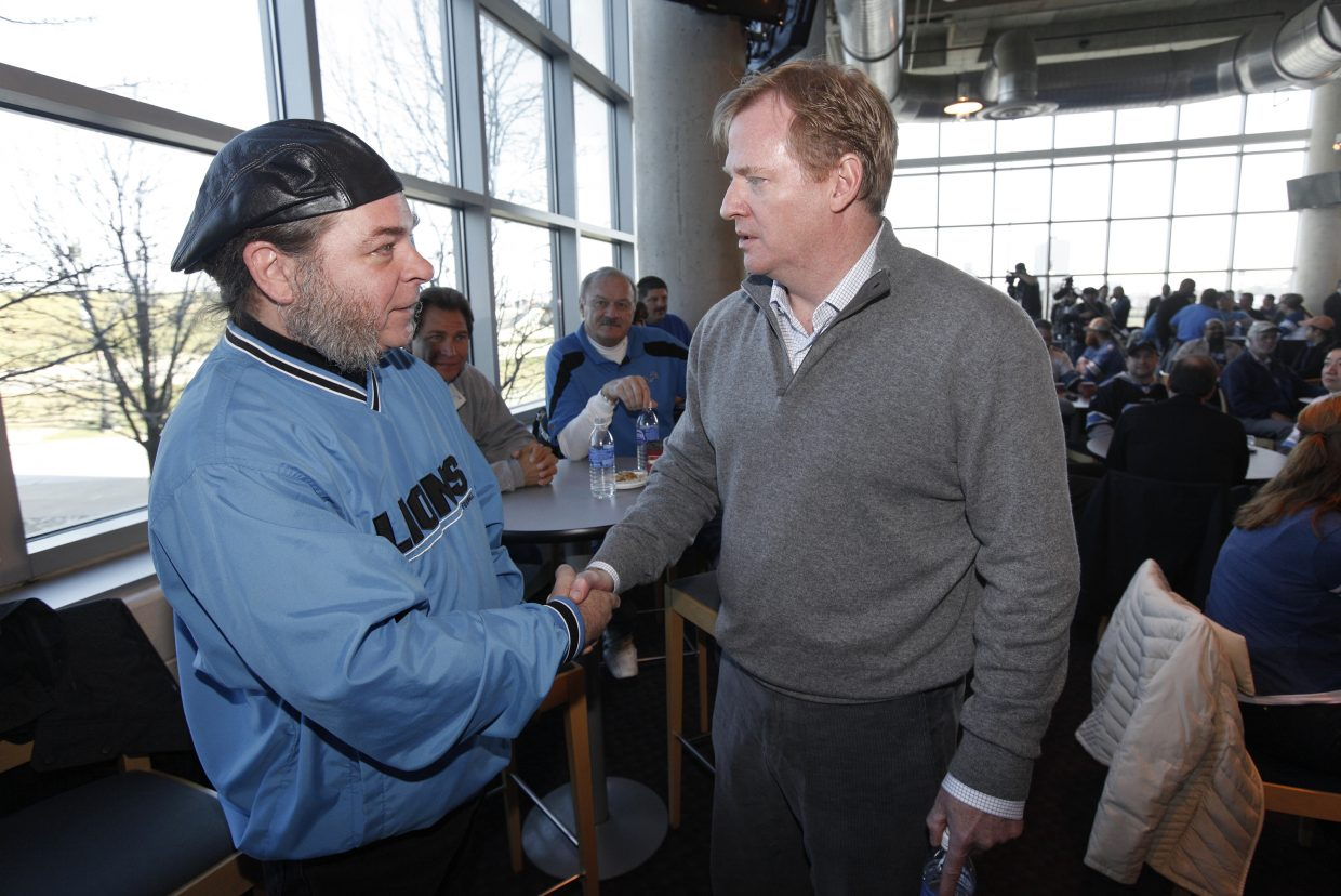 FILE - In this Dec. 11, 2011, file photo, NFL Commissioner Roger Goodell, right, speaks with Detroit Lions season ticket holder Keith O'Neill, of Warren, Mich., during a fan forum before an NFL game, in Detroit. for all of the public (and players' association) angst regarding Goodell, who enters his second decade in charge on Thursday, Sept. 1, 2016, he couldn't be held in higher esteem by most of the 32 team owners _ his bosses.  (AP Photo/Paul Sancya, File)