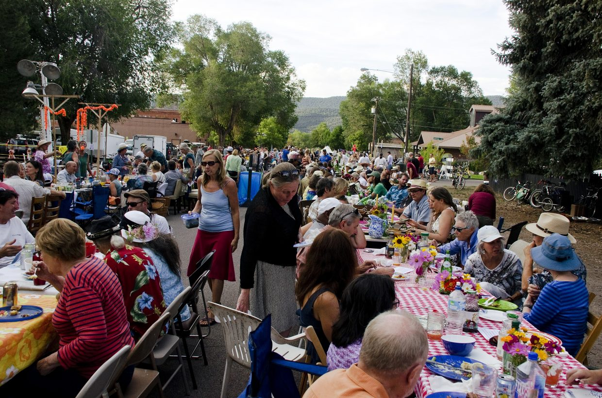 The second annual Our Town One Table community potluck brought several hundred people to downtown Carbondale, with nearly twice as many tables as last year.