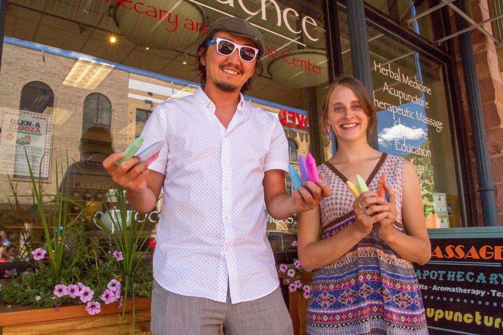 GlenX President Altai Chuluun and Providence Apothecary owner Chrissy Manes holding that chalk that will was used to paint the sidewalks during the first Glenapalooza event last month.