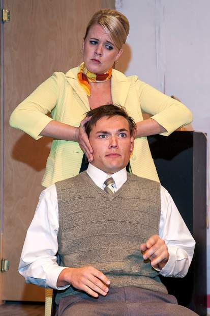 """Paige Ulmer, as Lufthansa stewardess Gretchen, and Scott Elmore, as Robert, find themselves caught up in a web of lies in the French comedy """"Boeing Boeing."""" The Sopris Theatre Company production of the classic farce runs Oct. 21-30 at Colorado Mountain College Spring Valley. Photo Scot Gerdes"""