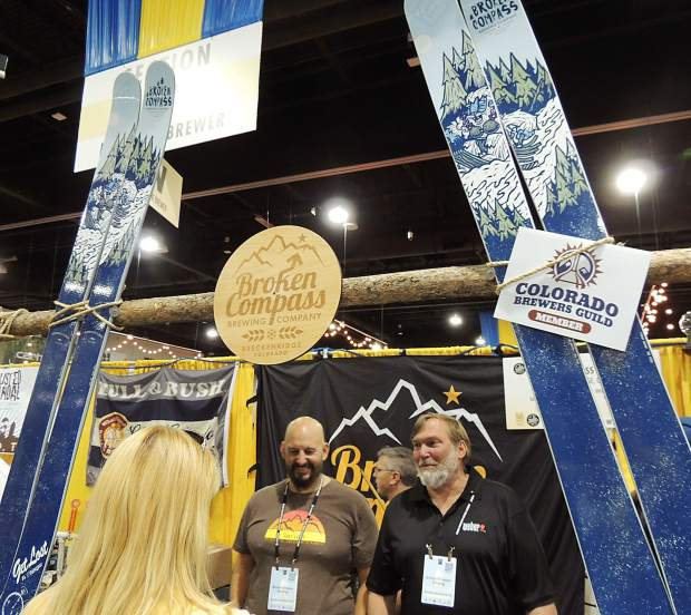 The guys from Broken Compass Brewing Co. out of Breckenridge celebrate a silver medal for their Ginger American Ale in the Herb and Spice Beer category at the Great American Beer Festival; there were 114 entries in the category.