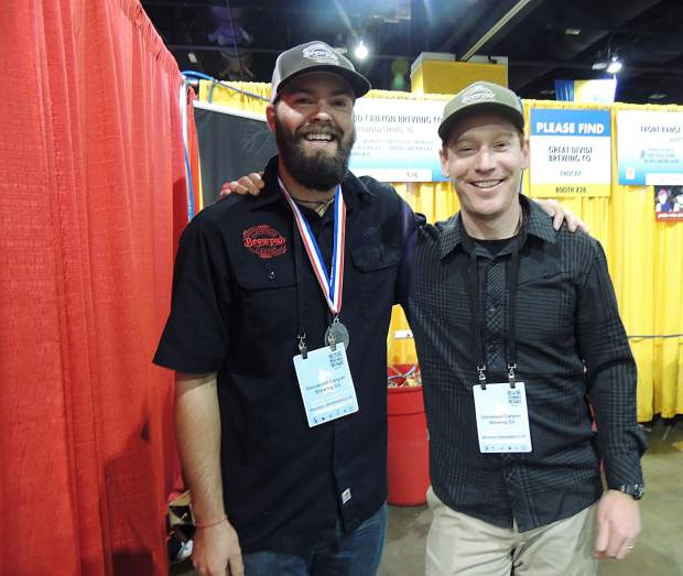 Glenwood Canyon Brewing Co.'s Todd Mallory and Cody Nelson celebrate their victory at the Great American Beer Festival. The brewery won a silver medal for their St. James Irish Red Ale in the Irish-Style Red Ale category; there were 80 entries in the category.