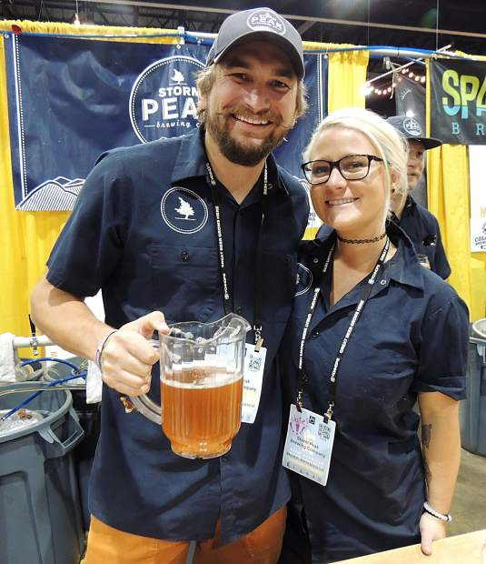 Wyatt Patterson and Julie Beckett, from Storm Peak Brewing Co. in Steamboat Springs, toast the Great American Beer Festival.
