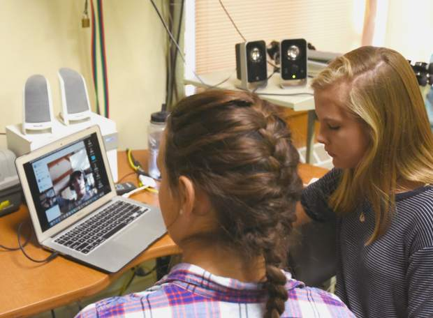 Nicole Peirson, left, and Linnea Sherman conduct a Skype session with Alan Poole, who is associated wit the Cornell University ornithology lab, as part of the students' osprey research.