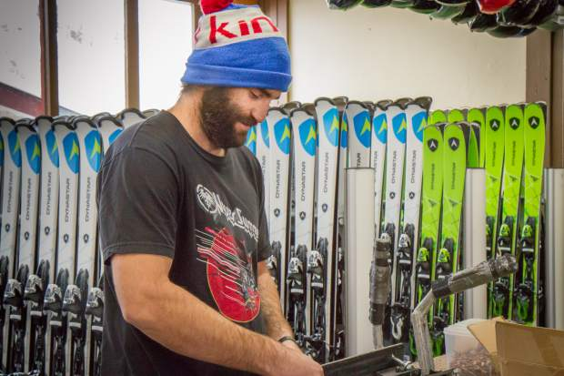 Sunlight Mountain Resort ski and snowboard rental shop tech Chris Sprayberry works to get the newly remodeled rental shop in order before opening day, scheduled for Dec. 9.