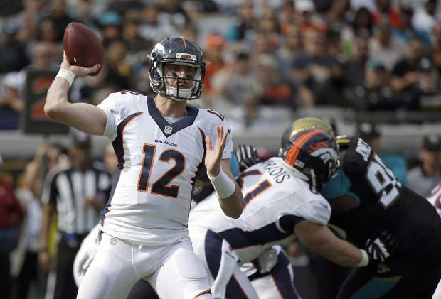 Denver Broncos quarterback Paxton Lynch (12) throws a pass against the Jacksonville Jaguars during the first half of an NFL football game in Jacksonville, Fla., Sunday, Dec. 4, 2016. (AP Photo/John Raoux)