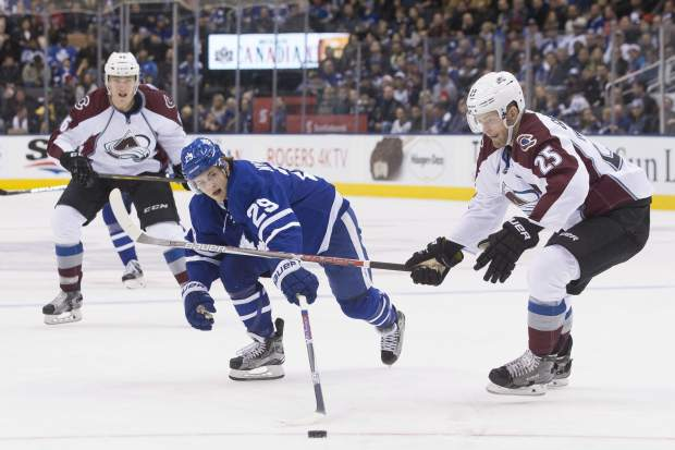 Toronto Maple Leafs' William Nylander (29) tries to reach a pass as Colorado Avalanche's Mikhail Grigorenko (25) closes during second period NHL hockey action in Toronto, on Sunday, Dec. 11, 2016 (Chris Young/The Canadian Press via AP)