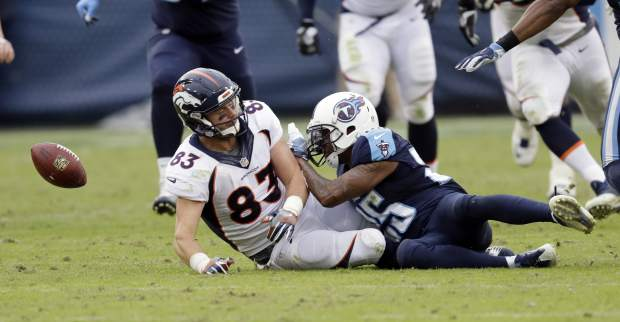 Denver Broncos tight end A.J. Derby (83) fumbles the ball as Tennessee Titans defensive back Rashad Johnson (25) closes in during the final minutes of the fourth quarter of an NFL football game Sunday, Dec. 11, 2016, in Nashville, Tenn. The Titans recovered the ball to hold onto a 13-10 win. (AP Photo/James Kenney)