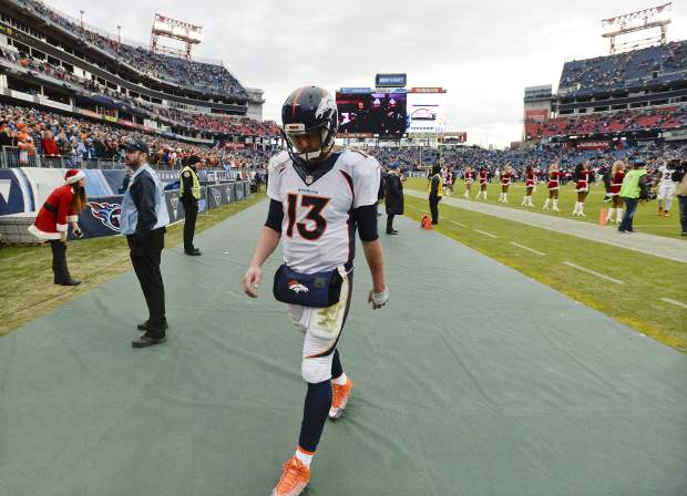 Denver Broncos quarterback Trevor Siemian leaves the field after the Broncos lost 13-10 to the Tennessee Titans in an NFL football game Sunday, Dec. 11, 2016, in Nashville, Tenn. (AP Photo/Mark Zaleski)