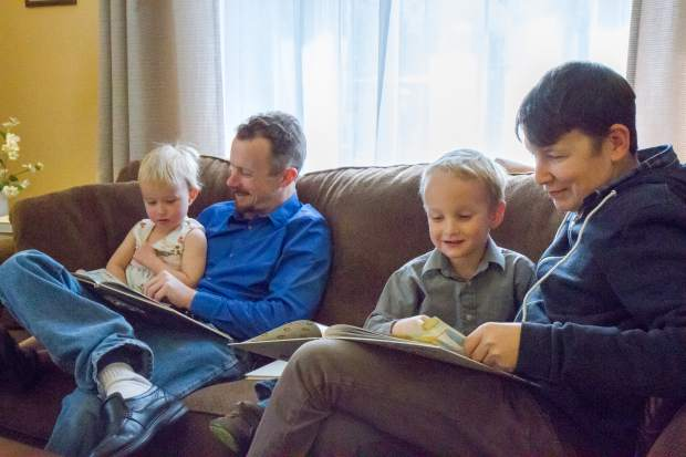Joel Belmont(left) and Brian Colley spend the afternoon reading with Alea and Samuel Belmont at the Christian Science Church in Glenwood Springs.
