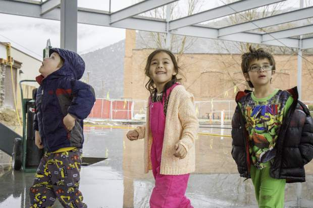 From left, Kingergartners Austin Allen, Vanessa Gonzalez and JJ Reyes check out the shell of the new Glenwood Springs Elementary School building during their