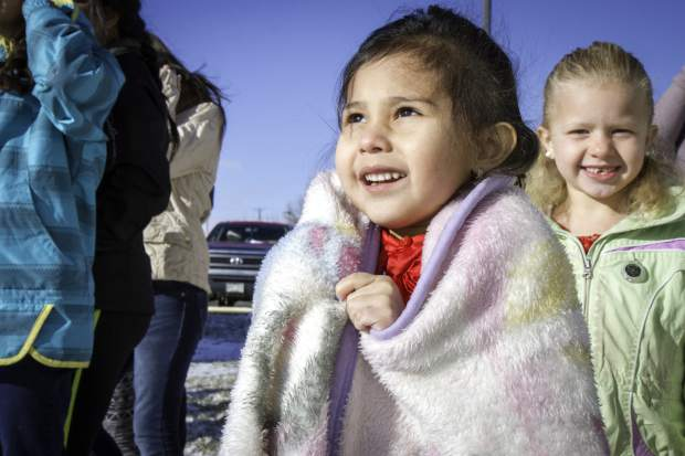 Four-year-old Abril Molina looks to the sky for the Classic Air Medical helicopter that made a special delivery to the E. Dene Moore Care Center in Rifle on Saturday afternoon. Santa and two of his elves were flown to the care center for a special visit with residents and a chance to lets kids tell Santa what they wanted for Christmas.