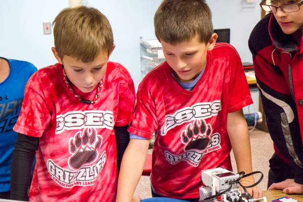 Glenwood Springs Elementary School fourth-graders Jacob Roggie, left, and Jerick Sorensen work on configuring the robot they will be taking to the tournament in Denver.