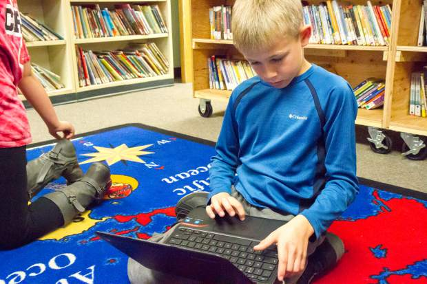Glenwood Springs Elementary School fourth-grader Jack Berkheimer does research on wolves as part of his Los Robos Lobos First Lego League team project.