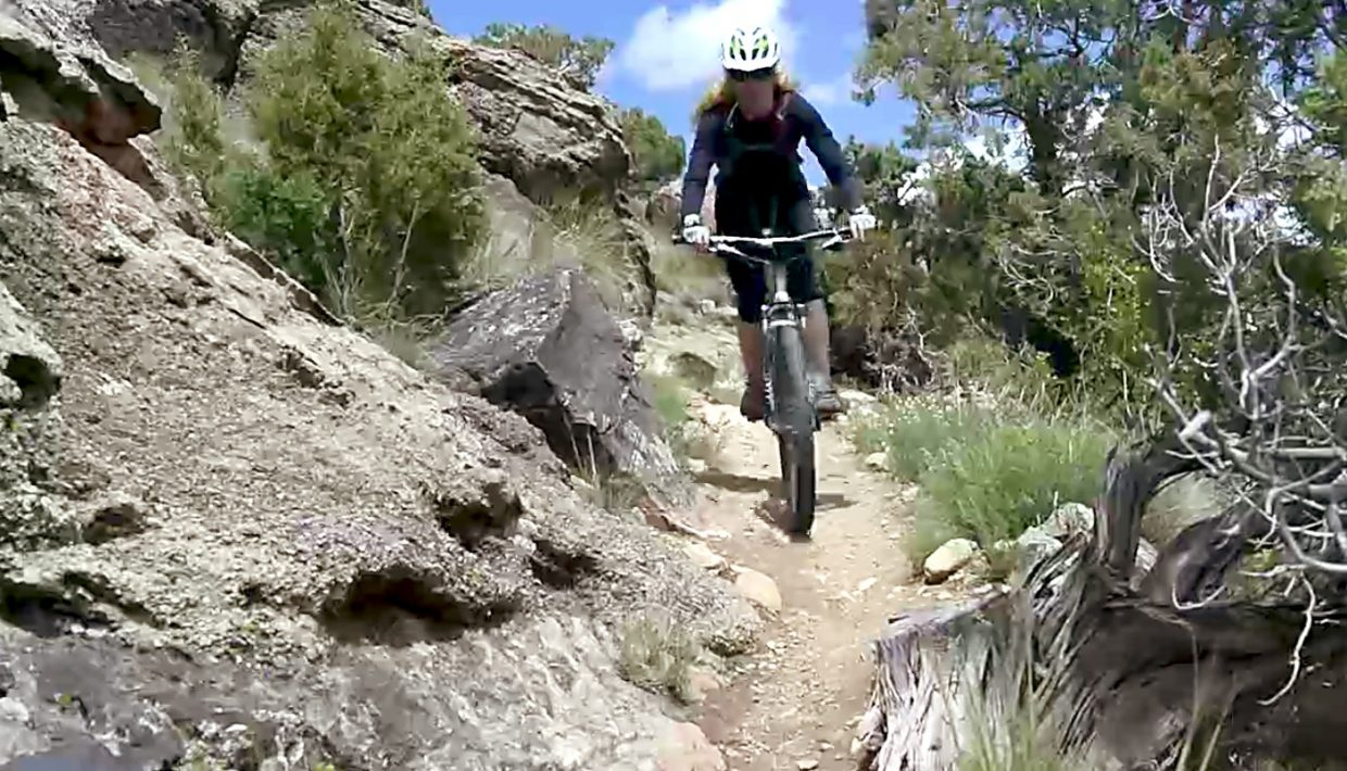 Host Shawna Henderson picks her way through boulders on singletrack in the Fruita area. Along with mountain biking, the entire Western Slope, from Fruita to Grand Junction and Palisade, is a Mecca for wineries and festivals.