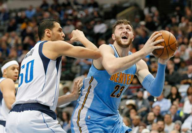 Dallas Mavericks' Salah Mejri (50) of Tunisia defends as Denver Nuggets center Jusuf Nurkic (23) of Bosnia Herzegovina post up for a shot attempt in the first half of an NBA basketball game, Monday, Dec. 12, 2016, in Dallas. (AP Photo/Tony Gutierrez)