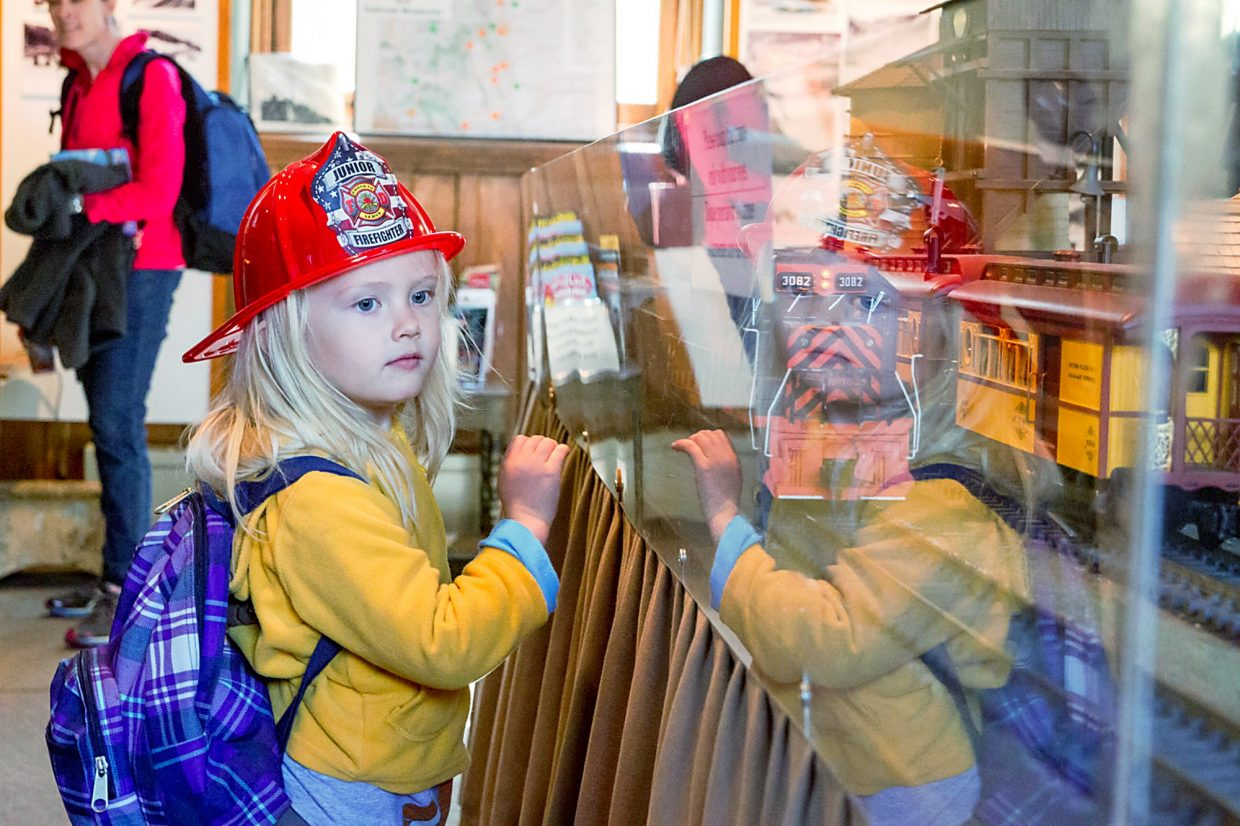 Three-year-old Ilse Bahrke from Denver watches the train set at the Glenwood Springs Railroad Museum Sunday afternon while waiting with her family for the eastbound Amtrak.