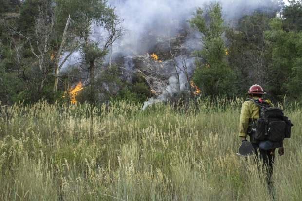 A firefighter prepared to start tackling the fire near Redstone in late July.