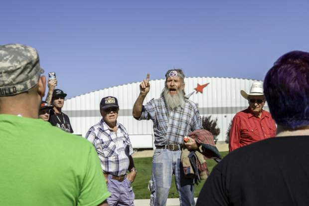 Donald Trump supporters argue with protestors while waiting in line to get into the rally at the Grand Junction Regional Airport in Grand Junction in October.