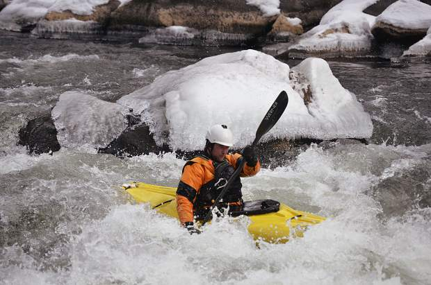 Kayakers suited up in heavy-duty warm gear Sunday for the traditional New Year's Day run on Shoshone.