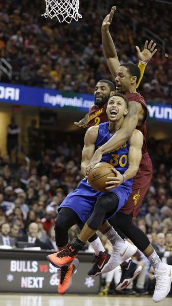 Golden State Warriors' Stephen Curry, front to back is fouled by Cleveland Cavaliers' Channing Frye as Kyrie Irving watches in the second half of an NBA basketball game, Sunday, Dec. 25, 2016, in Cleveland. (AP Photo/Tony Dejak)