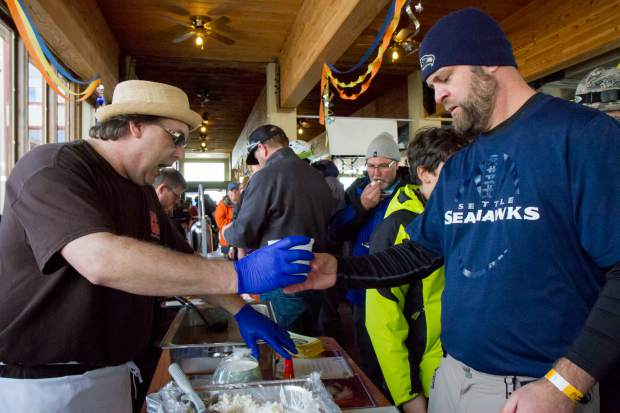 Lost Cajun owner Gabriel Griffin, left, hands out samples during the first ever Taste of Sunlight event at Sunlight Mountain's Ski Spree.