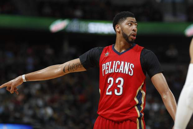 New Orleans Pelicans forward Anthony Davis directs his teammates on the floor while facing the Denver Nuggets in the first half of an NBA basketball game Sunday, March 26, 2017, in Denver. (AP Photo/David Zalubowski))