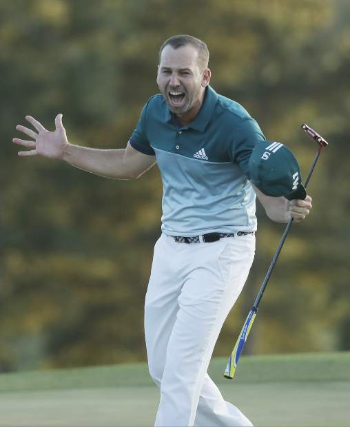 Sergio Garcia, of Spain, reacts after making his birdie putt on the 18th green to win the Masters golf tournament after a playoff Sunday, April 9, 2017, in Augusta, Ga. (AP Photo/Chris Carlson)