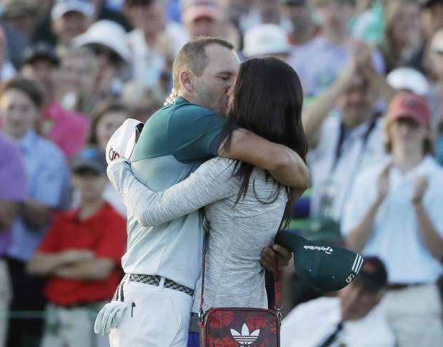 Sergio Garcia, of Spain, reacts with his fiancee Angela Atkins on the 18th hole after a playoff at the Masters golf tournament, Sunday, April 9, 2017, in Augusta, Ga.(AP Photo/David Goldman)